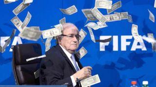 Dinheiro lançado a Blatter interrompe conferência